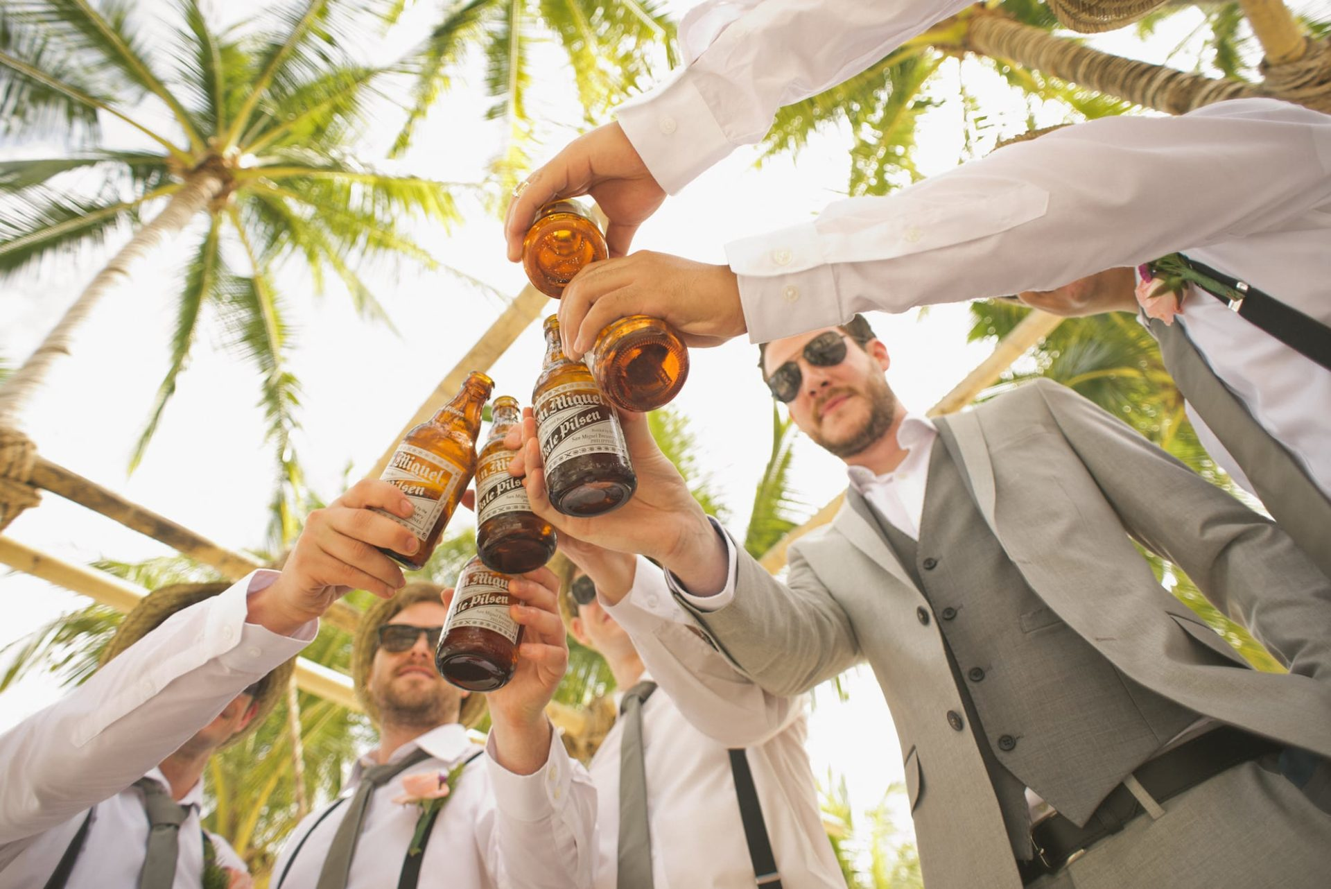 Group of friends celebrating with beer