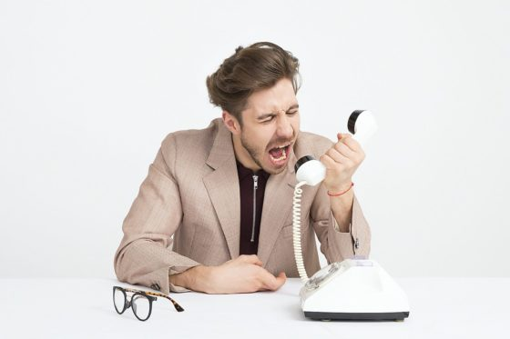 Men yelling no at work into the phone