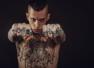 Tattooed guy with rings