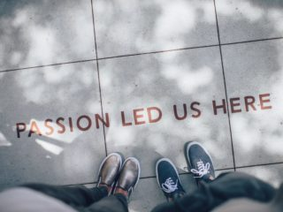 Passion sign on sidewalk.