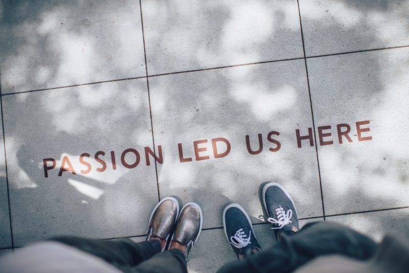 Passion sign on sidewalk.