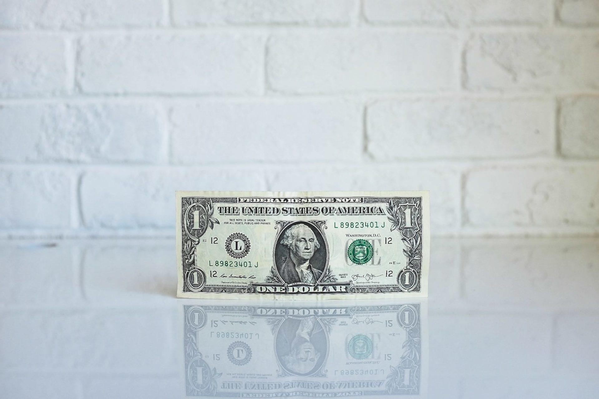 Dollar bill on table.