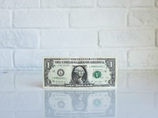 Dollar bill on table.