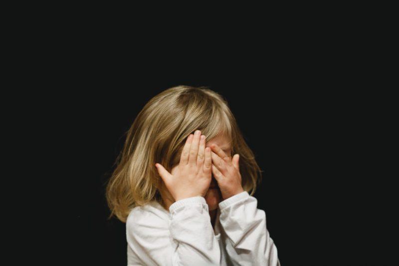 Little girl hiding face