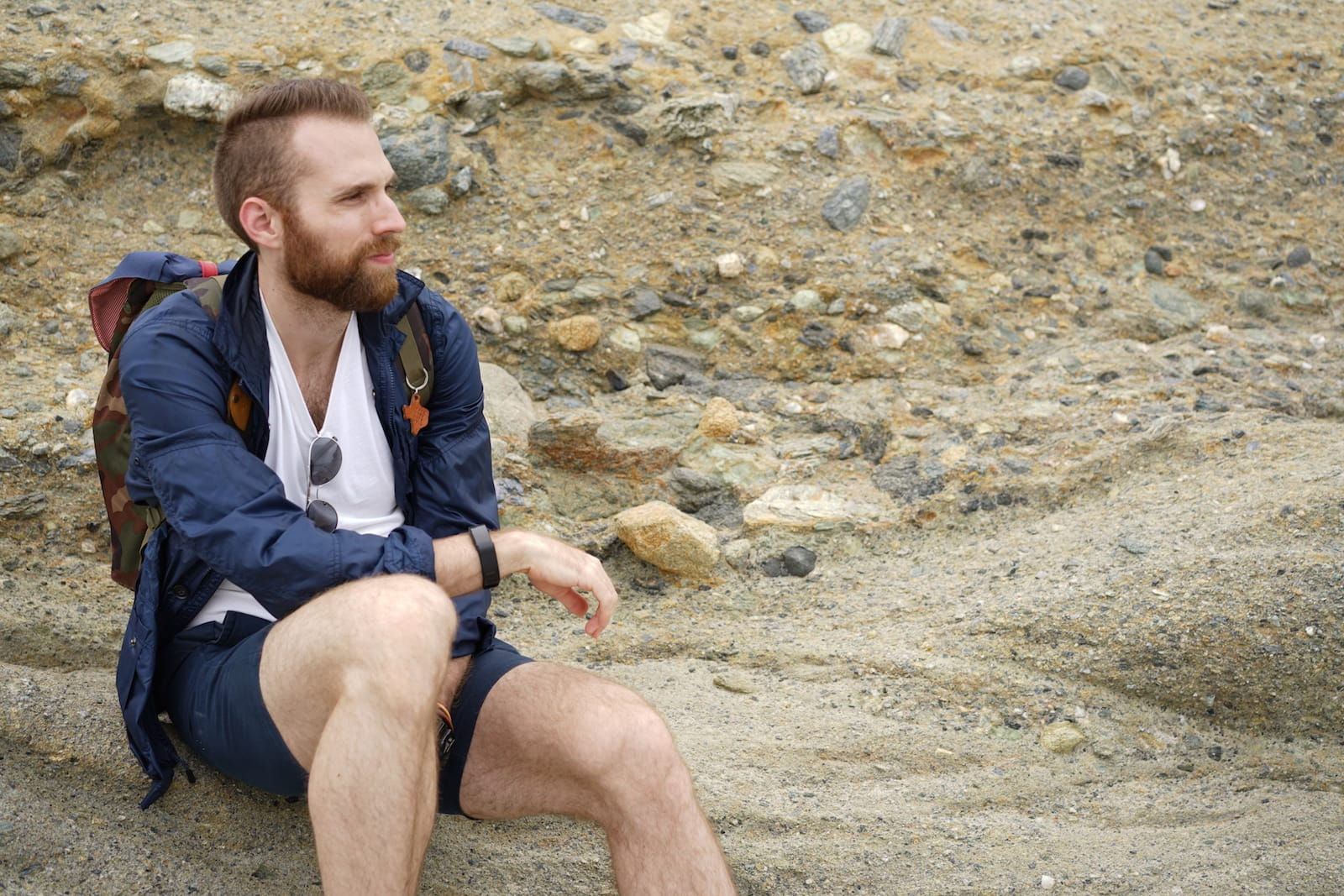 Adam sitting on a beach in Malibu