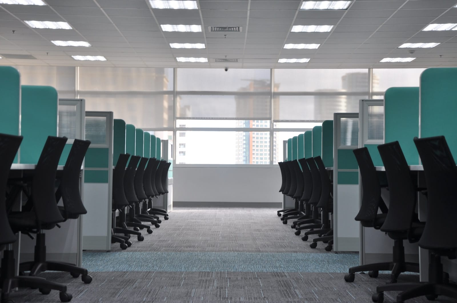 Empty row of desks and chairs in office.