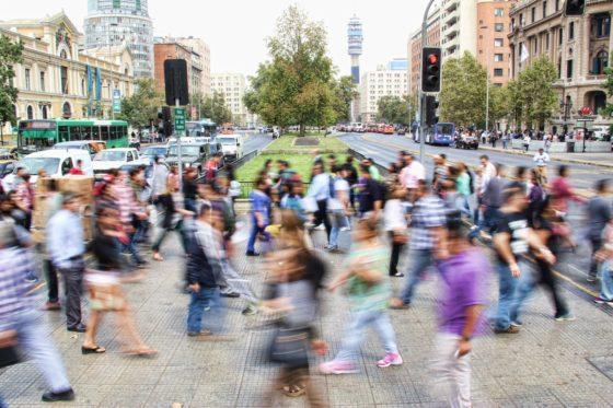 People walking fast on a busy street