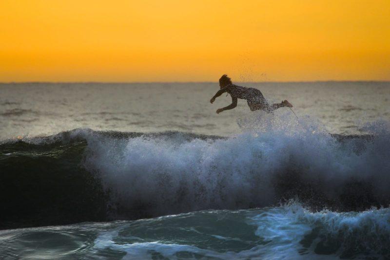 Man crashing on surfboard