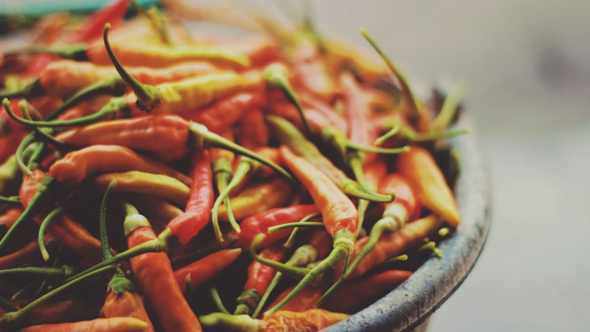 A bowl full of spicy chili peppers to show how zesty and spicy your life could get.